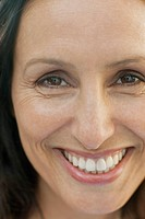 Close_up of healthy, smiling, middle_aged woman