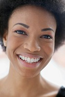 Portrait of smiling mid_adult woman with afro