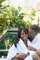 Couple cuddling and laughing at outdoor spa (thumbnail)