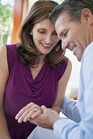 Couple looking at woman's ring together