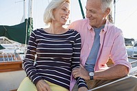 Senior couple looking at each other on sailboat