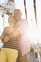 Senior couple hugging on sailboat