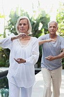 Senior couple doing Tai chi together