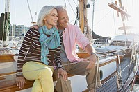 Senior couple sitting on sailboat