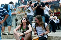 Foreign visitors sharing the atmosphere of the Bun festival at Pak Tai Temple, Cheung Chau, Hong Kong