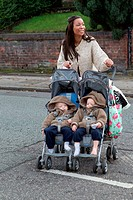 Mother crossing road with twins in buggy, This photo has extra clearance covering Homelessness, Mental Health Issues, Bullying, Education and Exclusio...