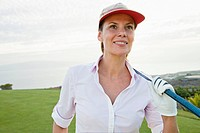 Portrait of woman on golf court