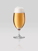 Beer glass on gray background