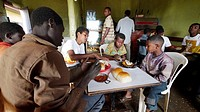 ETHIOPIA  The 'Salam Cafe' in Chagni, Beni Shangul Gumuz region  Boys having breakfast of beans