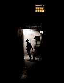 Young Indonesian going down a dark alley at night in Bandung Indonesia