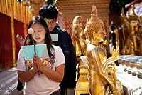 People praying at Doi Suthep temple in Chiang Mai Thailand