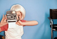 Teenage Girl Using an Instant Camera