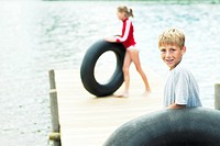 Children playing with inner tubes on a dock
