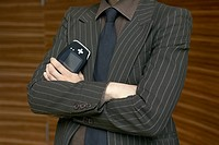 Businessman holding personal digital assistant