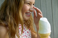 Girl eating soft_serve ice cream cone