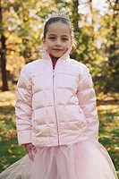 Little girl wearing pink coat and tutu