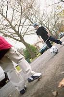 Boys kicking soccer ball