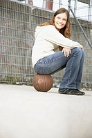 Girl hanging out at a basketball court