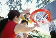 Asian Family Playing Basketball