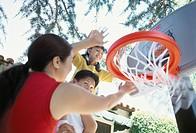 Asian Family Playing Basketball