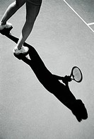 Shadow of Tennis Player Holding Tennis Racket