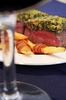 Beef fillet with a herb crust and melon wrapped in bacon