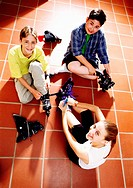 Kids Putting on Inline Skates