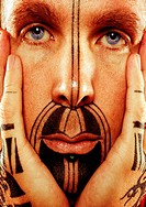 Man with Tattooed Face and Hands