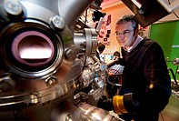 Synthetic diamond film production. Engineer with a machine used to synthesise a synthetic diamond film for use in medical applications, such as radiot...