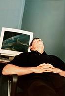 Man Resting near Computer