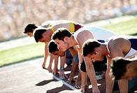 Young male athletes in starting position