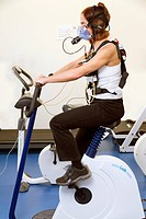 COPD research. Woman using an exercise bike during a study being carried out into chronic obstructive pulmonary disease COPD. Participants had changes...