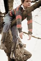 Boy on a Tree Branch