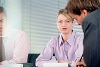 Distracted Businesswoman in Meeting