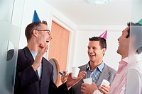 Businessmen Celebrating at Office Party