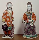 Couple of European figures, Famille verte (Green family) enamel porcelain statues destined for the Dutch market, China. Chinese Civilisation, Qing dyn...