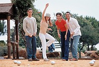 Two young couples playing boules