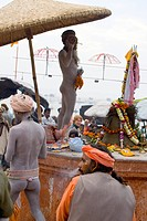 Hindu saint naga baba Shivdasgiri in Varanasi on Ganga river , Uttar Pradesh , India MR707A