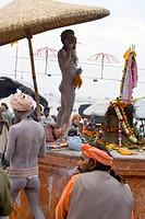 Hindu saint naga baba Shivdasgiri in Varanasi on Ganga river , Uttar Pradesh , India MR707A