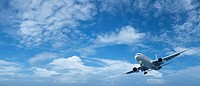 Jet aircraft is maneuvering in a blue cloudy sky. High resolutio
