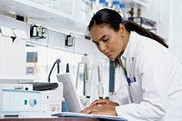 View of a female scientist working in lab setting
