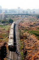 A train coming out of Vashi station in Navi Mumbai in Maharashtra ; India