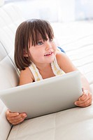 MODEL RELEASED. Toddler using a tablet computer