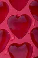 Detail view of an ice tray that makes heart_shaped ice cubes full of water