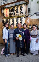 Family dressed in traditional costume, during Sanja Matsuri, in Senso-ji temple, Asakusa,Tokyo city, Japan, Asia