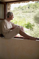 Man sitting on windowsill