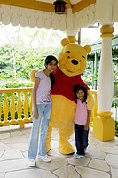 Girls portrait with Winnie Pooh at Hong Kong Disneyland ; Hong Kong MR477