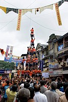 Govinda Dahi Handi ; human pyramid in process of breaking dahi handi ; Dadar west ; Bombay Mumbai ; Maharashtra ; India