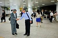 Two men say goodbye in Shinjuku station Shinjuku Tokyo city, Japan, Asia