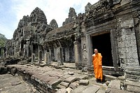 monk at ruins of Angkor Wat
